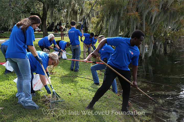 Volunteers using pond nets and pickers to remove trash
